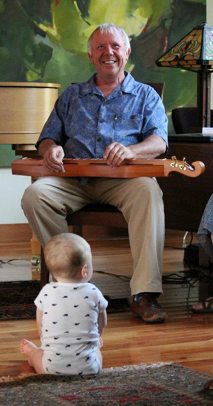 Don with dulcimer and baby